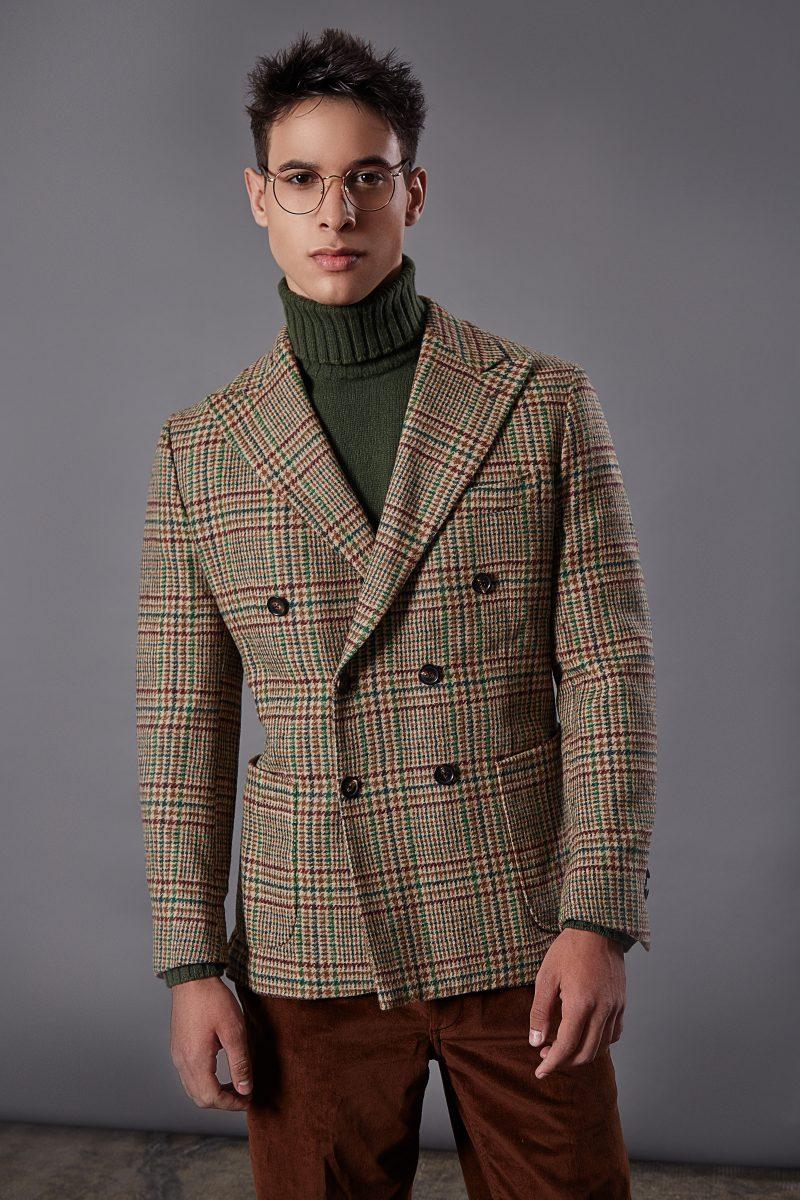 Coat, turtleneck sweater and trousers Doppiaa, sunglasses Moscot Originals