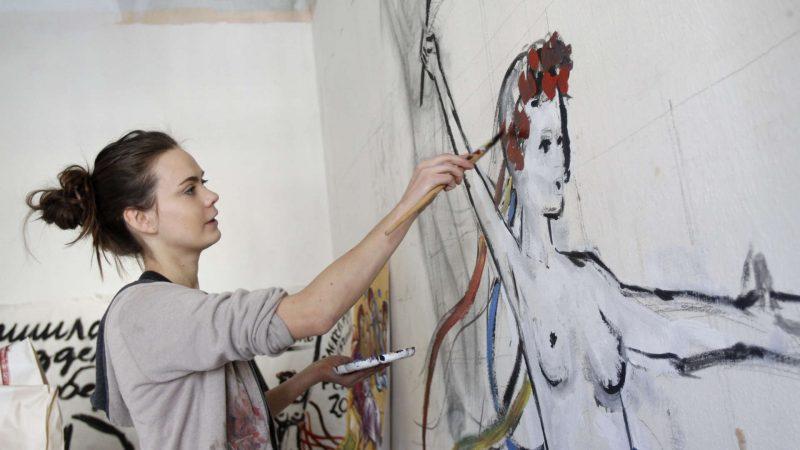 Femen activist Inna Shevchenko sits with her computer in an apartment in Kiev